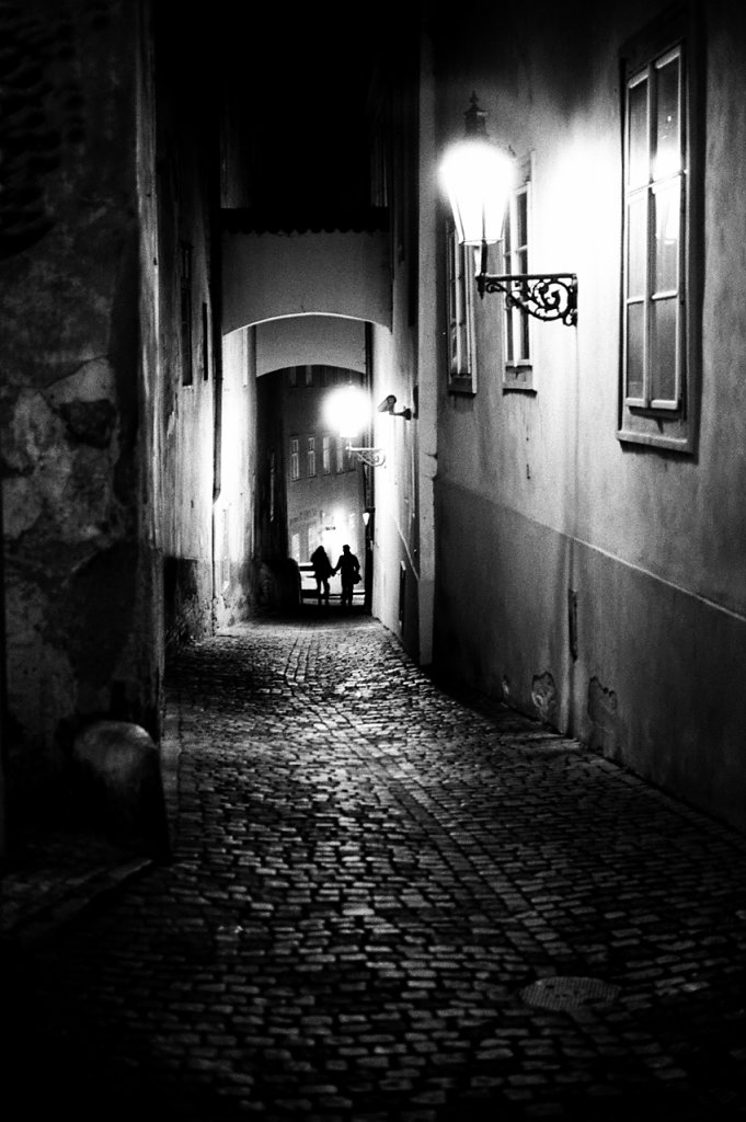 Two of them take a narrow dark street